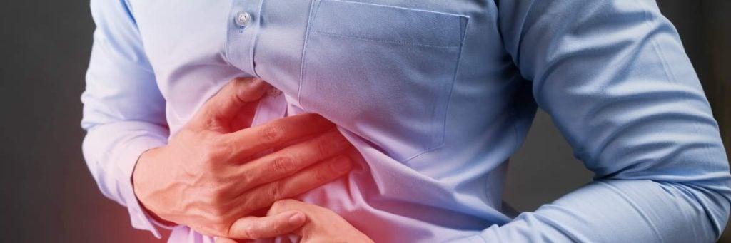 quais são os sintomas de dispepsia funcional